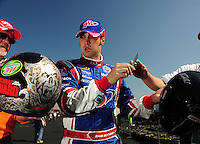 Apr 25, 2009; Talladega, AL, USA; NASCAR Sprint Cup Series driver Sam Hornish Jr signs autographs during qualifying for the Aarons 499 at Talladega Superspeedway. Mandatory Credit: Mark J. Rebilas-