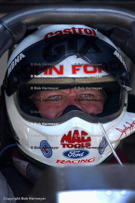 INDIANAPOLIS, IN - SEPTEMBER 6: John Force waits to drive in the NHRA Mac Tools US Nationals on September 6, 2002, at Raceway Park near Indianapolis, Indiana.