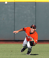 Virginia's Kenny Swab dives to reach a ball in the third inning. South Carolina beat Virginia 3-2 in 13 innings at the College World Series on June 24, 2011 in Omaha, Neb. (Photo by Michelle Bishop)..