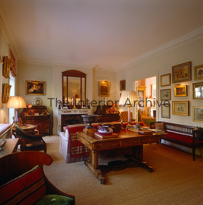 A pair of  desks on either side of the fireplace in the drawing room which is filled with Russian objects