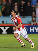 Paraguay's Nelson Valdez celebrates his penalty kick conversion, which guaranteed at least a draw through the first five kicks. Japan and Paraguay played in the second round of the 2010 FIFA World Cup in Loftus Versfeld Stadium, in Pretoria, South Africa, June 29th. After regulation and extra time ended 0-0, Paraguay advanced to the quarterfinals, 5-3, in a penalty-kick shootout.