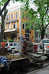 A construction worker is seen on North Dayton Street working across the street from a newly built Spanish colonial house, awkwardly placed amid the brownstone and brick buildings of Lincoln Park, in Chicago, Illinois on June 19, 2009.