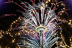 Seattle rings in the New Year with fireworks at the Space Needle on New Years in Seattle. Jim Bryant Photo.