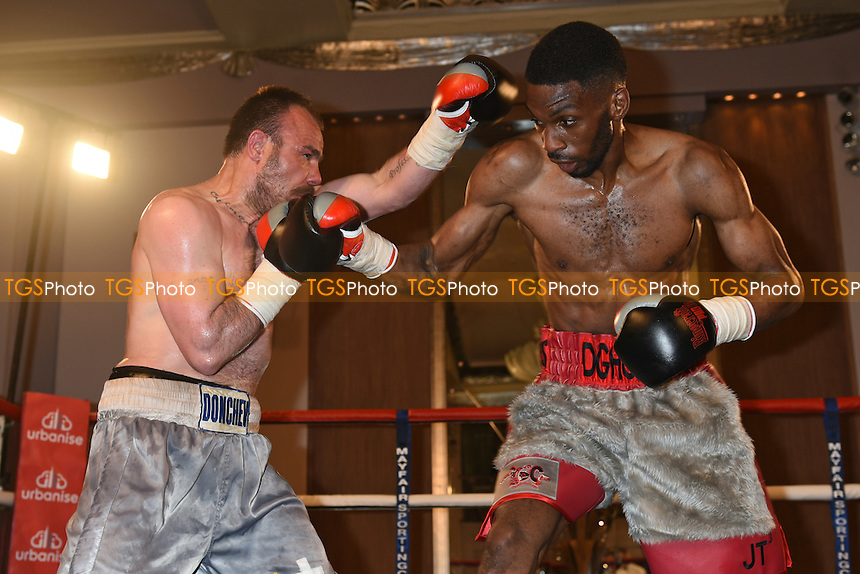 Asinia Byfield (silver/red shorts) defeats Danny Donchev - Boxing at the Park Lane Hotel, Mayfair, London - 02/06/15 - MANDATORY CREDIT: Philip Sharkey/TGSPHOTO - Self billing applies where appropriate - contact@tgsphoto.co.uk - NO UNPAID USE