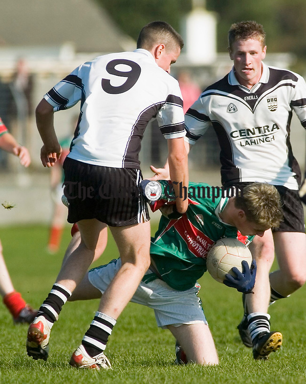 Kilmurry Ibrickane's Colm Donnellan goes down under pressure from Ennistymon's Francis O Loughlin  during the Minor final at Miltown. Photograph by John Kelly.