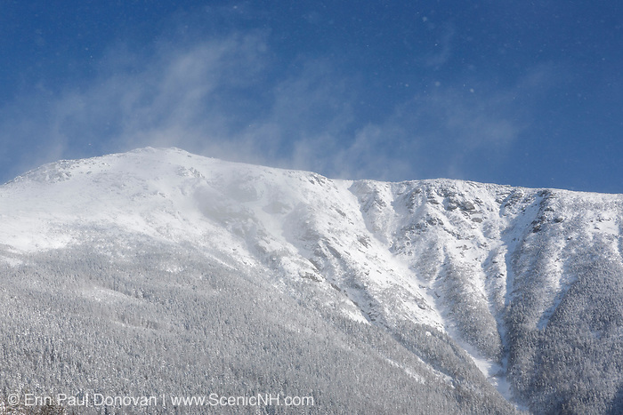 Franconia Ridge from along the Old Bridle Path in the White Mountains, New Hampshire during the winter months. Strong winds cause blowing snow in the scene.