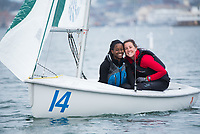 Skipper Lucie Ford, '20, right, and Crew Alexa Percell,'20, have fun as Salve practices in the Newport Harbor.