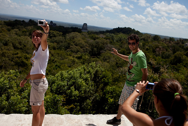"Tourists at archeological site ""Tikal"" insite the Mayan Biosphere Reserve."