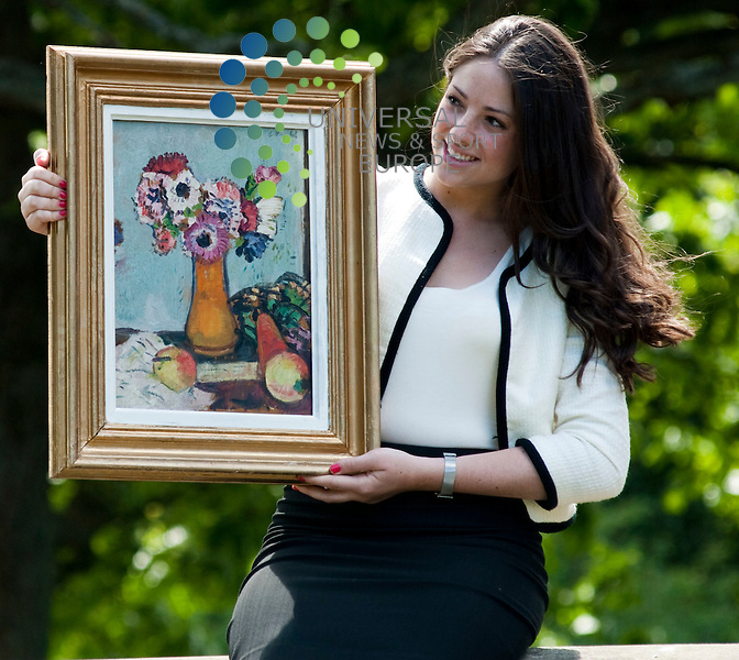 Caitlin Cruickshank of Lyon and Turnbull with the painting 'Still life with fruit and anemones' by the Scottish Colourist George Leslie Hunter. The painting is on show at an exclusive preview at Pollok House. It is now valued at £30,000 and will be up for aution Thursday 26th May...Pollok House, Pollok Country Park, 2060 Pollokhaws Road, Glasgow, Scotland G43 1AT.  Picture: Euan Anderson/Universal News And Sport (Scotland) 24th May 2010.