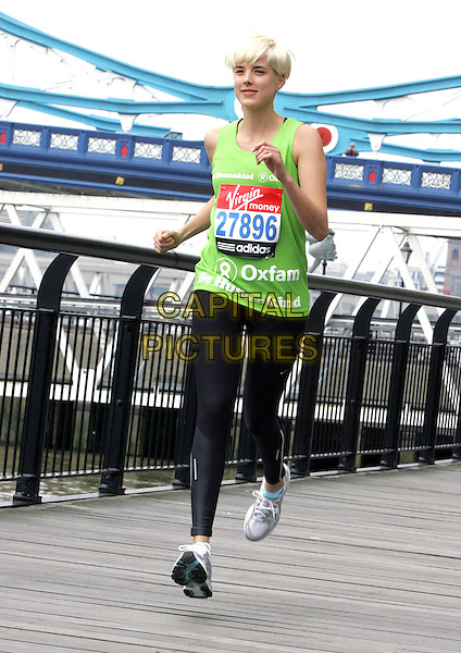 AGYNESS DEYN.Celebrities line up for London Marathon Photocall at the the Tower Hotel,  London, England..April 15th 2011.exercise full length black sleeveless vest top black spandex trainers sneakers run running jog jogging gesture.CAP/ROS.©Steve Ross/Capital Pictures.
