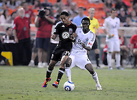D.C. United midfielder Andy Najar (14) goes against Vancouver Whitecaps FC midfielder Gershon Koffie (28). D.C. United defeated The Vancouver Whitecaps FC 4-0 at RFK Stadium, Saturday August 13 , 2011.