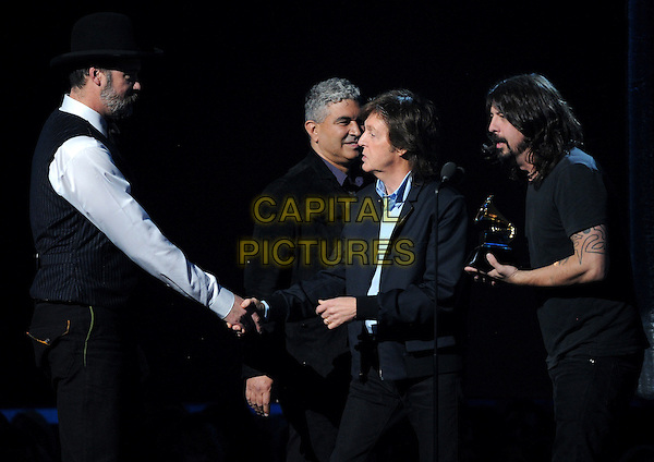 LOS ANGELES, CA - JANUARY 26 : Paul McCartney, Krist Novoselic, Dave Grohl, and Pat Smear accept the Best Rock Song award for 'Cut Me Some Slack' onstage at The 56th Annual GRAMMY Awards at Staples Center on January 26, 2014 in Los Angeles, California. <br /> CAP/MPI/PG<br /> &copy;PGMicelotta/MediaPunch/Capital Pictures