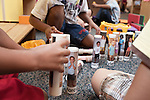 September 14, 2011. Raleigh, NC. . Each child in the class has a plastic tube action figure with their photo on it.. Project Enlightenment, a public pre-kindergarten program for at risk children, has been threatened with closure due to state wide budget cuts..