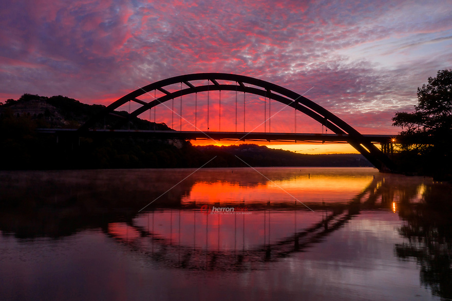 Bright color pops out of the sky in the sunrise taken of the 360 Pennybacker Bridge. This is probably Austin's most iconic structure and beloved by Austinites and visitors alike.
