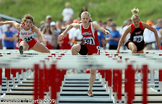 RAPID CITY, SD - MAY 30:  Nevada Sorenson of Lincoln, center, leads Anna Gagliano of Rapid City Central and Kaila Nordmeyer of Brandon Valley in the girls Class AA 100 meter hurdle finals during the 2009 South Dakota State Track Meet Saturday in Rapid City. (Photo by Dave Eggen/Inertia)