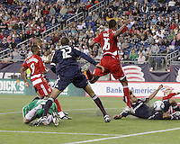 New England Revolution defender Kevin Alston (30) slides to save a goal after New England Revolution goalkeeper Preston Burpo (24) unsuccessfully dives for the ball.  The New England Revolution drew FC Dallas 1-1, at Gillette Stadium on May 1, 2010