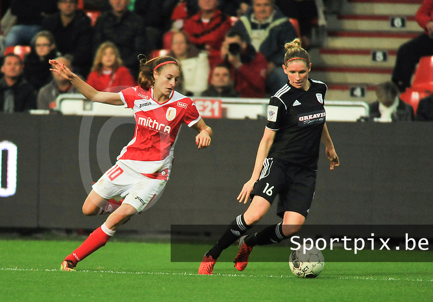 20131009 - LIEGE , BELGIUM : Standard's Tessa Wullaert (left) pictured with Glasgow Leane Ross (right) during the female soccer match between STANDARD Femina de Liege and  GLASGOW City LFC , in the 1/16 final ( round of 32 ) first leg in the UEFA Women's Champions League 2013 in stade maurice dufrasne - Sclessin in Liege. Wednesday 9 October 2013. PHOTO DAVID CATRY