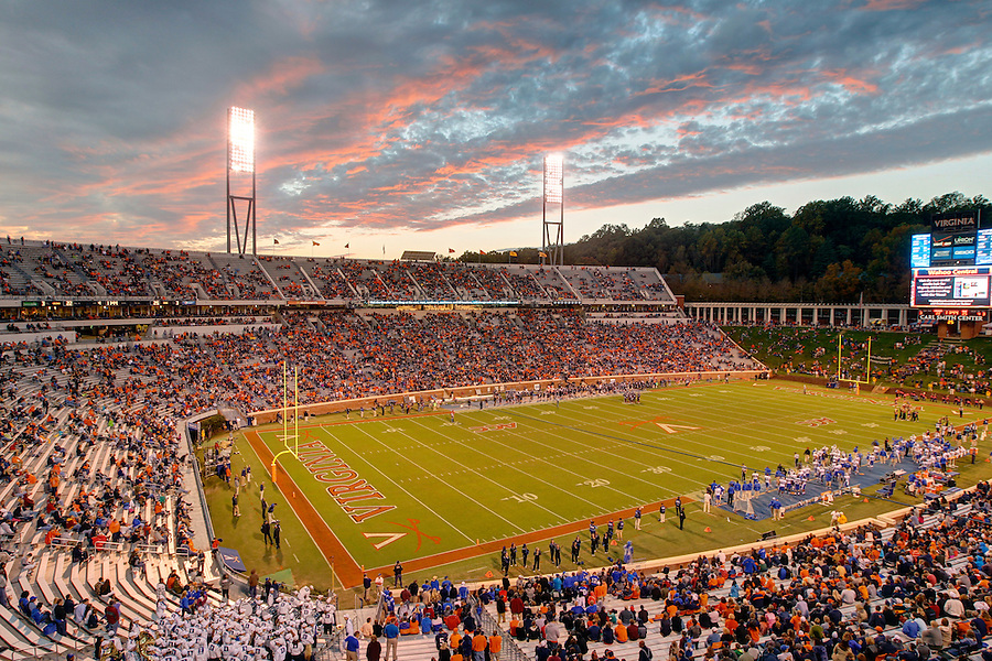 A colorful sunset over Scott Stadium as the Virginia Cavaliers play football at the University of Virginia in Charlottesville, Va. Photo/Andrew Shurtleff