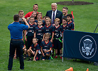 United States president Donald J. Trump poses for photos with kids attending the White House Sports and Fitness Day at the White House in Washington, DC, May 30, 2018. <br /> CAP/MPI/RS<br /> &copy;RS/MPI/Capital Pictures