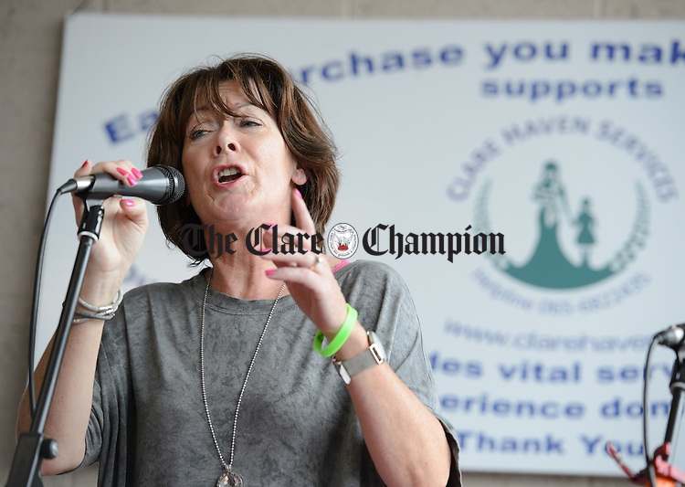 Ann Droney Kirrane sings at a celebratory concert to thank customers and supporters at the Clare Haven Services shop during Fleadh Cheoil na hEireann in Ennis. Photograph by John Kelly.