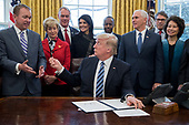 US President Donald J. Trump (C) hands his pen to Director of the Office of Management and Budget (OMB) Mick Mulvaney (Front L), after signing an executive order entitled, 'Comprehensive Plan for Reorganizing the Executive Branch', beside members of his Cabinet in the Oval Office of the White House in Washington, DC, USA, 13 March 2017. Also in the picture is Administrator of the Small Business Administration Linda McMahon (2-L), Secretary of the Interior Ryan Zinke (3-L), US Ambassador to the UN Nikki Haley (4-L), Secretary of Housing and Urban Developement (HUD) Ben Carson (Back C), US Vice President Mike Pence (3-R), Secretary of Energy Rick Perry (2-R) and Secretary of Transportation Elaine Chao (R).<br /> Credit: Michael Reynolds / Pool via CNP