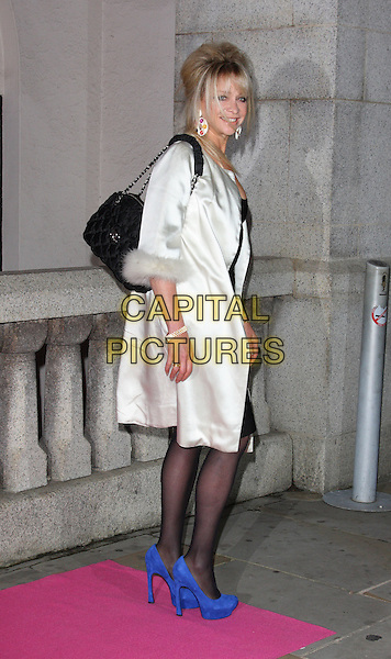 JO WOOD .At the Inspiration Awards For Women at the Cadogan Hall, London, England, UK, October 6th 2010.full length blue cobalt shoes side white cream fur trimmed sleeve coat black bag tights suede platform .CAP/ROS.©Steve Ross/Capital Pictures
