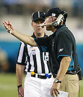 Jacksonville Jaguar head coach Tom Coughlin argues a call with a referee during an NFL preseason game in Jacksonville, FL on Friday, August 15, 2002.  Tampa bay won the game 20 to 0. (Photo by Brian Cleary/ www.bcpix.com )