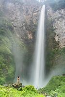 Tourist at 120m Sipisopiso Waterfall, Lake Toba (Danau Toba), North Sumatra, Indonesia