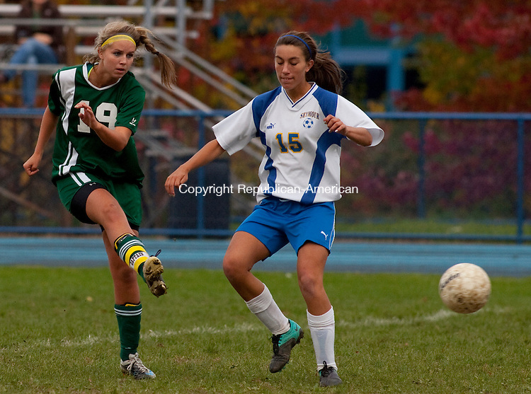 SEYMOUR, CT, 18 OCTOBER 2010-101810JS09-Holy Cross' Kelsey Nolan (19) passes the pall past  Seymour's Stephanie Orts (15) during their game Monday at Seymour High School. <br />  Jim Shannon Republican-American