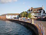 Thatched historic houses on the seafront at Paignton, Devon, England, UK