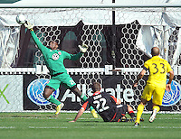Bill Hamid (28) of D.C. United saves a shot on goal from Federico Higuain of The Columbus Crew. The Columbus Crew defeated D.C. United  2-1, at RFK Stadium, Saturday March 23, 2013.