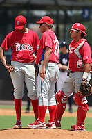 GCL Phillies coach Les Lancaster talks with pitcher Luis Morales #71 and catcher Angel Chavarin #23 during a game against the GCL Yankees at the New York Yankees Complex on June 24, 2011 in Tampa, Florida.  The Yankees defeated the Phillies 9-0.  (Mike Janes/Four Seam Images)