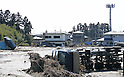 March 14, 2011: Residence covered in mud and truck is collapsed in Gamou, Miyagino district, Sendai City, near the mouth of Nanakita River.(Photo by Mainichi Newspaper /  Aflo)
