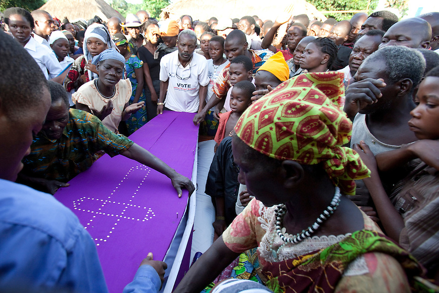 18 may 2010 - Yambio, Western Equatoria State, South Sudan - Relatives and community at the funeral of Gabriel Makana. Three Sudanese were brutally murdered when their car was ambushed by the Lord's Resistance Army (LRA) on the road just few miles from Tambura on May 17, 2010. The victims were government officials in the State Ministry of Education: Mr. William Arkangelo Baabe, Mr. Gabriel Makana (49 years old) and Baraka Josefati (25 years old). Over the weekend 30 to 40 LRA attacked five miles north of the town of Tambura, close to the borders with the Central African Republic and the Democratic Republic of the Congo. The LRA group ransacked a medical center, looted food and other items, and abducted seven people. Western Equatoria state has been rocked by LRA activities since 2006. Thousands of people have been forced from their homes as brutal attacks continue against the civilian population in the region and neighboring DRC and CAR. Photo credit: Benedicte Desrus