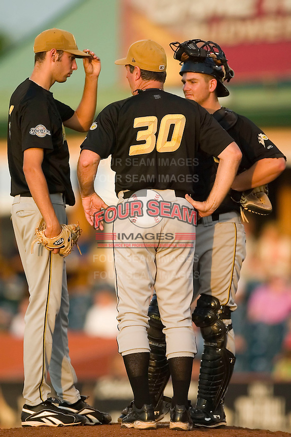West Virginia pitching coach John Curtis (30) chats with starting pitcher Mike Ramlow (7) and catcher Andy Bouchie (9) at Applebee's Park in Lexington, KY, Thursday, June 7, 2007.
