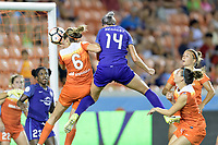 Houston, TX - Saturday June 17, 2017: Alanna Kennedy heads the ball into the Houston goal with Morgan Brian defending during a regular season National Women's Soccer League (NWSL) match between the Houston Dash and the Orlando Pride at BBVA Compass Stadium.