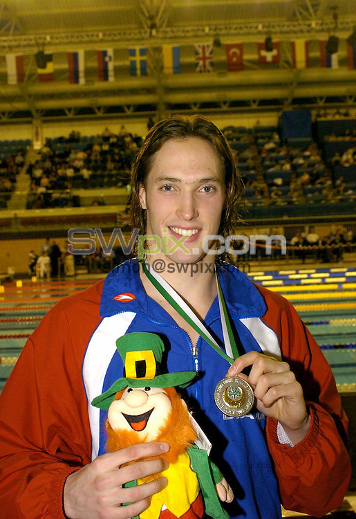 PICTURE BY :Ben Duffy/SWpix.com..International Swimming, European Short Course swimming championships Dublin 2003 .......12/12/2003..Great Britain's Robin Francis show off his Silver medal for the mens 400m IM..?COPYRIGHT PICTURE>>SIMON WILKINSON>>0870 0920092>>