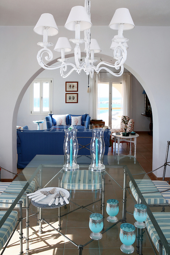 The blue sea, the bright sky, the playful colors and the love for the Greek summers are combined with harmony in a 300sqm house in Paros island of Greece.