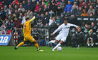 Preston North End's Callum Robinson vies for possession with Swansea City's Martin Olsson during the Sky Bet Championship match between Swansea City and Preston North End at the Liberty Stadium, Swansea, Wales, UK. Saturday 11 August 11 2018