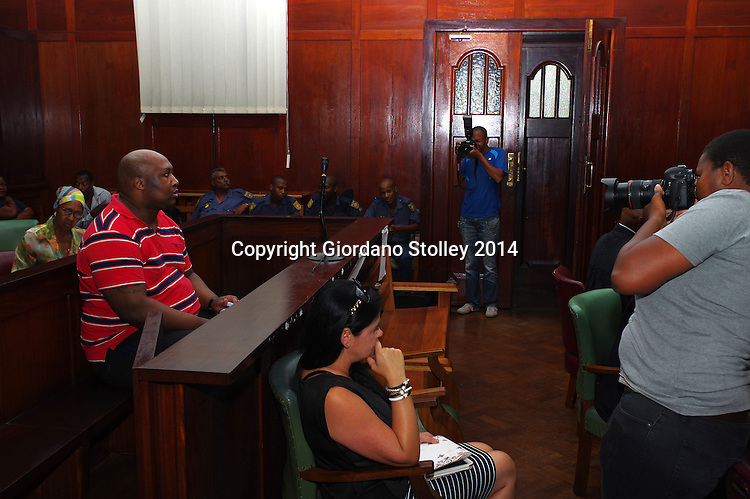 DURBAN - 19 December 2014 - Former Blue Bulls rugby player Phindile Joseph Ntshongwana sits in the dock at Durban High Court  as press photographers take their last pictures of him moments before he was due to be sentenced to five terms of life imprisonment by Judge Irfaan Khalil. Ntshongwana was convicted of killing four people with an axe, kidnapping and raping a woman as well as assaulting two other people. Picture: Allied Picture Press/APP