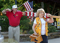 NWA Democrat-Gazette/DAVID GOTTSCHALK Rick Bailey and his wife Sydney, both Fayetteville Lions Club members, prepare to distribute and post Monday, May 29, 2017 U.S. flags on the square in downtown Fayetteville. The installation of the flags on holidays is a service project for the club and are posted through out the city including Dickson Street, the downtown square and parts of College Avenue.