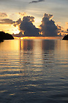 Palau, Micronesia -- Sunset with rain clouds on the horizon.
