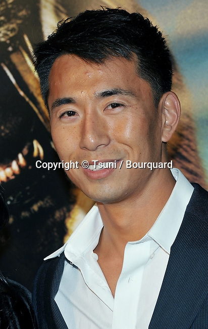 James Kyson Lee and girlfriend<br /> 10,000 BC Premiere at the Chinese Theatre In Los Angeles.<br /> <br /> headshot<br /> eye contact<br /> smile