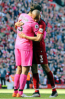 Liverpool's Alisson Becker (left) and Fabinho console each other as they are left dejected at the final whistle<br /> <br /> Photographer Rich Linley/CameraSport<br /> <br /> The Premier League - Liverpool v Wolverhampton Wanderers - Sunday 12th May 2019 - Anfield - Liverpool<br /> <br /> World Copyright © 2019 CameraSport. All rights reserved. 43 Linden Ave. Countesthorpe. Leicester. England. LE8 5PG - Tel: +44 (0) 116 277 4147 - admin@camerasport.com - www.camerasport.com