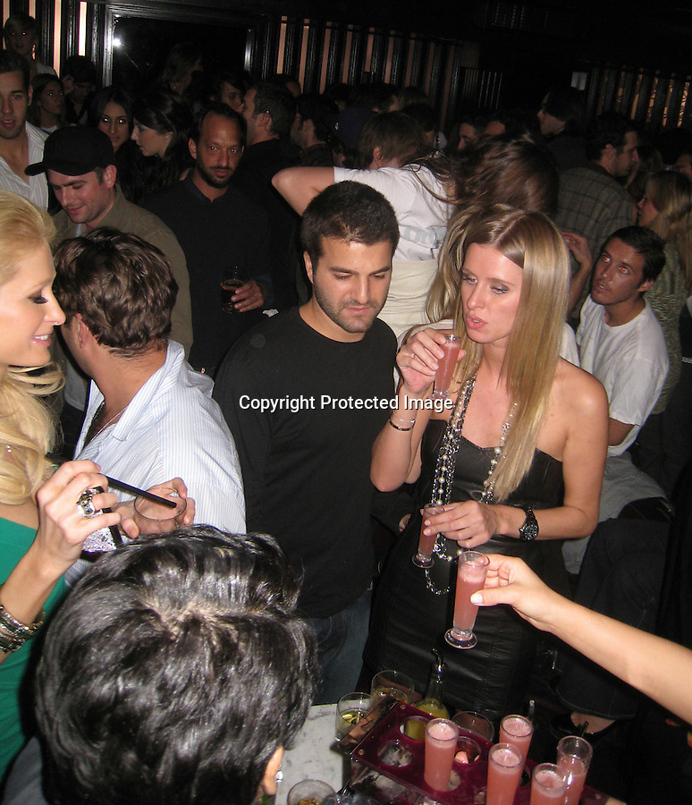 .11-11-08.Tuesday night Exclusive.Fox Tail night club in Los Angeles had a party for Nylon Magazine.  Paris Hilton was arguing with her boyfriend Benji Madden but once they started drinking, dancing & taking shots it seemed to fizzle. Nicky Hilton was was also drinking and dancing with her bofyfriend. . DJ AM was back and better than ever. ..AbilityFilms@yahoo.com.805-427-3519.www.AbilityFilms.com