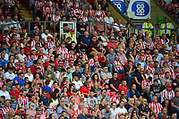 Lincoln City fans watch their team in action<br /> <br /> Photographer Andrew Vaughan/CameraSport<br /> <br /> The EFL Sky Bet League Two - Lincoln City v Swindon Town - Saturday August 11th 2018 - Sincil Bank - Lincoln<br /> <br /> World Copyright &copy; 2018 CameraSport. All rights reserved. 43 Linden Ave. Countesthorpe. Leicester. England. LE8 5PG - Tel: +44 (0) 116 277 4147 - admin@camerasport.com - www.camerasport.com