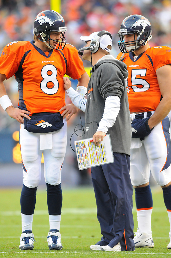 14 NOVEMBER 2010:  Broncos head coach Josh McDaniels speaks with quarterbacks Kyle Orton and Tim Tebow  during a regular season National Football League game between the Kansas City Chiefs and the Denver Broncos at Invesco Field at Mile High in Denver, Colorado. The Broncos beat the Chiefs 49-29.