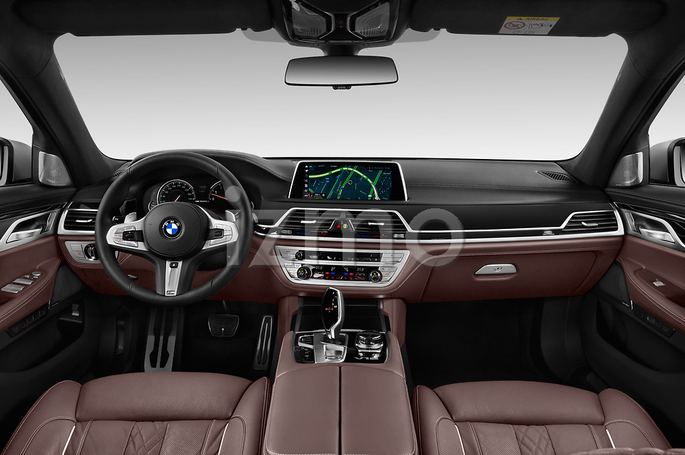 Stock photo of straight dashboard view of a 2018 BMW 7 Series M760 Li 4 Door Sedan
