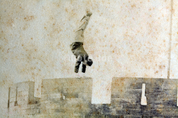 man doing a hand stand on the top of a castle tower