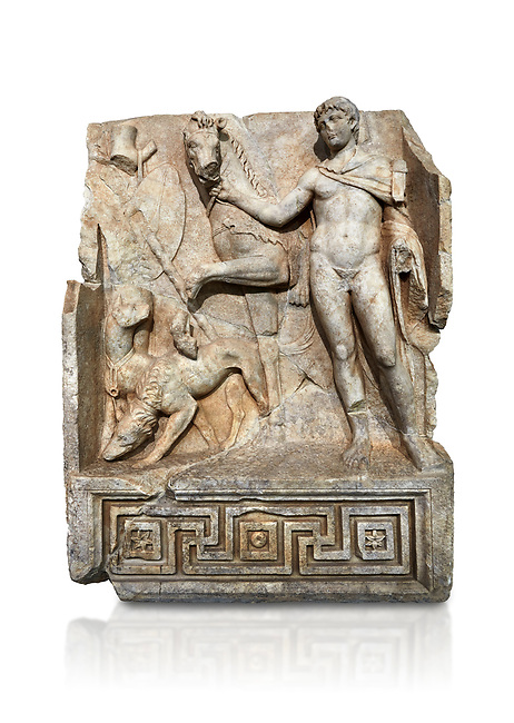 Roman Sebasteion relief  sculpture of Royal Hero with hunting dogs,  Aphrodisias Museum, Aphrodisias, Turkey.     Against a white background.<br /> <br /> A diademed youth stands with his horse and hunting dogs. At the left an oval shield (foreign) hangs from a leafless tree, against which leans a long thin club. The Royal hero in this and the relief to the left is probably a local founder such as Assyrian King Ninos, claimed as founder of their city by the Aphrodisians.